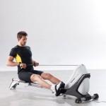 Гребной тренажер: укрепляем мышцы спины и пресса